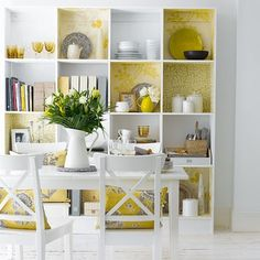 I'm not normally a fan of yellow, but I love the wallpaper in the cube shelf.