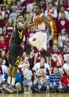 Indiana's Yogi Ferrell (11) changes course and looks for a teammate to pass to as Iowa's Roy Devyn Marble (4) goes up to defend against his e... --  #IUCollegeBasketball