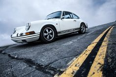 Fifteen years ago, Mr. Cris Huergas ignited the early 911 hot rod revolution, by applying a humble list of factory sanctioned modifications to this 1969 911S. The car attracted the attention of Mr. Freeman Thomas who, together with Cris, founded R-Gruppe, a club that in turn inspired countless 911 enthusiasts, to adopt the same modifications as set forth in the factory's Sports Purpose Manual.
