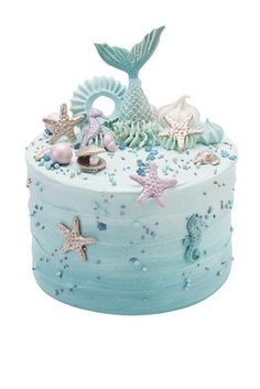 #Mermaid #Underthesea #Cake - #rippled #buttercream #cake #decorated with #golden #shells #pastel #seahorses #pearlescent #meringue #kisses and topped with a #blue #mermaid #tail