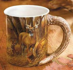 """RUSTIC RETREAT - WHITETAIL DEER MUG by Rosemary Millette ~  Savor a warm cup of cocoa or an Irish coffee in a 16oz. mug that will rekindle some of your favorite outdoor recollections. The raised, nature-themed images and sculpted handles make these stoneware mugs cherished collectibles. Microwave and dishwasher safe. 16 oz., 4-1/2"""" high."""