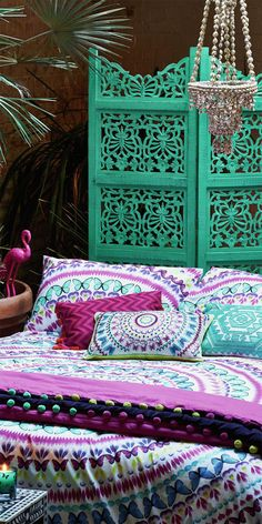 Moroccan Bedroom Ideas rich teal walls, moroccan lanterns and a dramatic headboard made