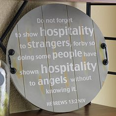"""Angels Unaware Tray 20"""" Hand-crafted in India, this tray shares the message from Hebrews 13:2 and also doubles as a wall hanging (keyhole on the back)."""