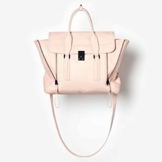 "3.1 Philip Lim Pashli Satchel Blush+Black Hardware - Black-nickel buckle at flap closure - Optional, adjustable crossbody strap - Vertical expandable zippers beneath flap - Interior zip pocket - Calfskin leather 14 1/2""W x 11 1/2""H x 5""D. (Interior capacity: large.) 4"" strap drop; 19"" - 23"" shoulder strap drop.   Condition: Like new condition. Comes with original tags (dust bag not included). Small mark on the upper right side. Light scratching on the front lock. 3.1 Phillip Lim Bags…"