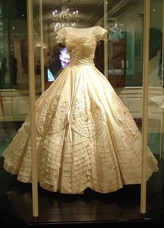 Jacqueline Bouvier Kennedy's wedding dress worn Sept.12, 1953 when she married John F. Kennedy; displayed at JFK Library and Museum in 2003 to commemorate the 50th anniversary of their wedding; probably will not be displayed again in this way because the weight of the dress is causing the fabric to tear.