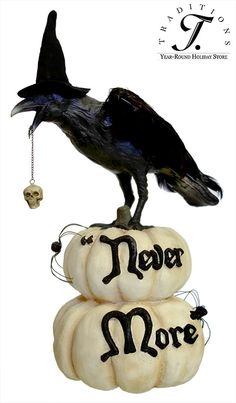 """""""Never More"""" raven on pumpkins.  $80.  Call me crazy, but I think with a a few small foam craft pumpkins & a Dollar Store raven, you could do this yourself..."""