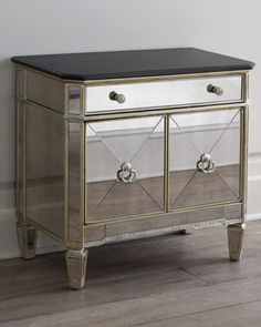 Mirrored chest adds pizzazz to an entry hall, living area, or bedroom. Made of hardwood with mirrored veneers on front and sides. Black granite top. Non-mirrored areas have an antiqued silver finish w