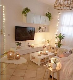Retro industrial TV lounge spot in white color! White tone flies against the windows backdrop, however it additionally orchestrates with the wood and calfskin furniture. Present day seating furniture and candles in spot will result in boho plan all in the shade of white and genuinely don't miss plant pot here.