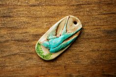 Flying Blue Sparrow Pendant with Hand Painted Woodland Branch Designs Polymer clay