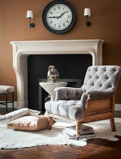 limestone fireplace #deconstructed leather wallpaper #studiorevolution family room