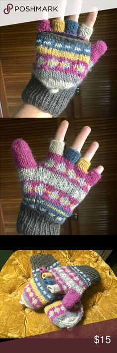 Fingerless Gloves Wool Nepal Boho Knit Beautifully simple way to keep your fingers warm and still use your phone! 100% Wool gloves/mittens made in Nepal bought from World Market. Inside is fleece lining. Just don't use them enough in Ca! Fold over mitten buttons back, so fingers can be used. Great with all your Boho outfits and stylish while being functional and warm! World Market Accessories Gloves & Mittens