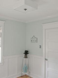 Craftsman trim around door and window, board and batten.