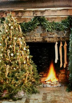 Log Cabin Christmas...stockings were hung on the hearth...tree.