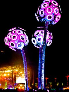 """""""Wish"""" 50 ft. Art Installation at Coachella--my fav installation by far of the 2011 music fest. Depicts 3 massive dandelions losing their seeds in the wind. Interacts with sound through awe inspiring displays of light."""