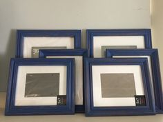 A personal favorite from my Etsy shop https://www.etsy.com/listing/244184627/navy-blue-picture-frames