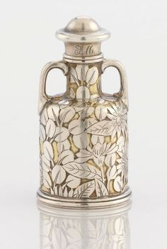 AN AMERICAN SILVER AND SILVER GILT PERFUME BOTTL