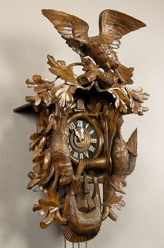 a huge carved cuckoo clock with eagle and game