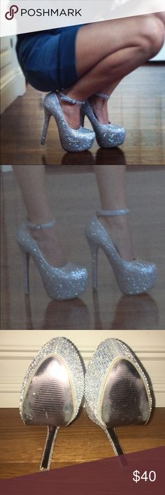 Rhinestone Heels Gorgeous rhinestone heels! Worn only once! If you love bling then these are definitely for you! The heel is about 6 in and the platform is 1.5 in.  All rhinestones are in tact! It's a silver shoe with crystals that have an iridescence to them! The way the light reflects off them they are absolutely gorgeous! Shoes Heels