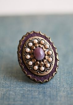 """Lavender Love Affair Indie Ring 35.99 at shopruche.com. Beautiful and vintage-inspired, this plum hued ring is adorned with glowing faux pearls, shimmering accents, and ornate brass hardware.Adjustable band, Pendant: 1.75"""" long"""