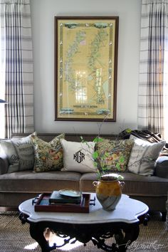 Interesting mix of patterns... like the mix of the feed sack pillows with the monogram pillow creating a more traditional look. sophisticated cottage style