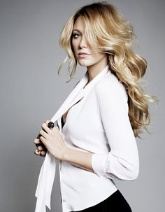 Blake Lively -accent on the full sexy hair, simple white blouse and in my world a black pencil skirt and ankle strap heels.