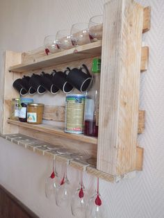 #Kitchen, #PalletDiyIdeas, #RecycledPalletShelves I just cut a piece of a pallet, added two boards of the same pallet, one that I break so she can receive stemware. Some nails to hang cups and then once sanded I hung the shelf on the wall!