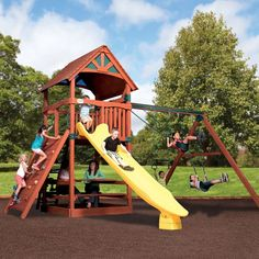 Play Set Shown With: • Titan Treehouse Jumbo • Wood Roof • 3 Position Swing Beam • 2 - Belt Swings • Trapeze Bar • Fort Angle Braces • Rocket Slide • Rock Wall • Jumbo Picnic Table Tree House Swing Set, Rainbow Play Systems, High Deck, Family Leisure, Cedar Roof, Building For Kids, Shed Plans, Olympians, Wood