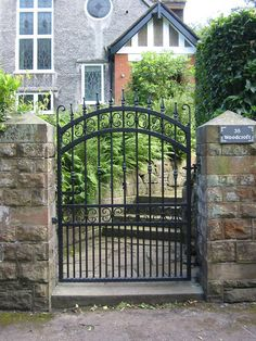 wrought iron gates and railings are incredible gate choice to have in your home. It is because wrought iron is excellent from the durability and its expressions Rod Iron Fences, Iron Fence Gate, Wrought Iron Garden Gates, Metal Gates, Driveway Gate, Iron Gate Design, Fence Design, Online Home Design, Side Gates