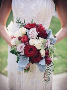 Gorgeous Bridal Bouquet: Cream Roses, Pastel Lavender Roses, Red Roses, Red Piano Spray Roses, Broad Leaf Dusty Miller, Green Foliage