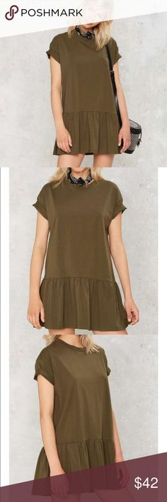 Ruffle dress by nasty gal We know you're always down to ruffle things up. This tee dress is army green and features a crew neck, short sleeves, ruffle at hem, and loose silhouette. Unlined.  *Polyester/Spandex  *Runs true to size  *Model is wearing size S  *Machine wash cold  *Imported. Never worn! Brand new! Nasty Gal Dresses Mini