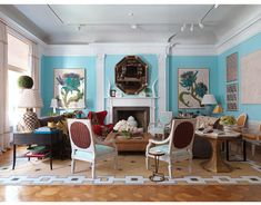 At this year's Kips Bay showhouse, Bunny Williams mixed furnishings from her BeeLine Home collection with a dashing red Egg chair from Design Within Reach. Its curves glow against walls painted Benjamin Moore's California Breeze, a blue echoed in the Quadrille Veneto fronts and seats of armchairs.