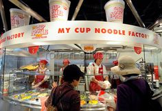 Visitors order toppings for their own original cup noodle at the My Cup Noodle Factory inside cup noodle maker Nissin's ramen (noodle) museu...