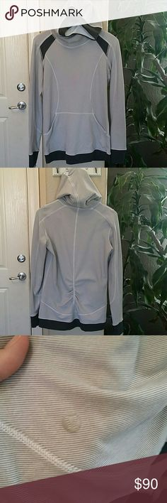 Lululemon base runner hoodie Lululemon base runner hoodie. Wee stripe white and gray. Excellent condition.  Washed once and hung dry. Only tried on. I LOVE this hoodie. Not sure I want to sell yet. Goes for 90$ + on ebay. lululemon athletica Sweaters