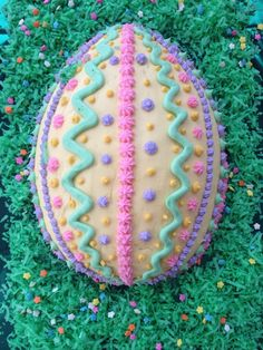 Easter egg cake from a football shaped cake pan. Decorated by: Desirée Correnti Ladd Ostereikuchen v Easter Egg Cake Pan, Easter Bunny Cupcakes, Easter Eggs, Cupcake Dress Cake, Cupcake Cakes, Cookie Cake Designs, Shaped Cake Pans, Desserts Ostern, Fantasy Cake