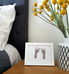 baby framed footprints on bed side table
