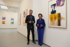 Norway's Queen Sonja (R) and Magne Furuholmen of Norwegian band A-ha pose in front of paintings at the opening of their joint exhibition in London on September 27, 2016..The show entitled Texture, is a portfolio of ten prints by Norway's Queen Sonja and Magne Furuholmen, made in support of The Queen Sonja Print Award (QSPA).  / AFP / DANIEL LEAL-OLIVAS / RESTRICTED TO EDITORIAL USE - MANDATORY MENTION OF THE ARTIST UPON PUBLICATION - TO ILLUSTRATE THE EVENT AS SPECIFIED IN THE CAPTION