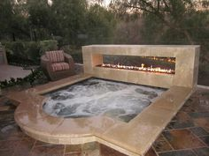 Outdoor fireplace and spa~
