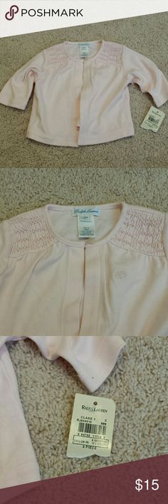 Pink Ralph Lauren sweater. New with tags Pink Ralph Lauren sweater. New with tags (sweater only used to be a 3 piece set) Color pink Size 6 month Ralph Lauren Shirts & Tops Sweaters