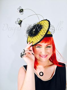"""A beautiful and well thought out artistic Kentucky derby design with 2 bumblebees hovering over the top of it from couture milliner Rebecca Bergmann and this one is obviously named """"BumbleBee"""" Bee Hat, Hat Stores, Kentucky Derby Hats, Well Thought Out, Fascinator, Trendy Fashion, Celebrity Style, Captain Hat, Couture"""