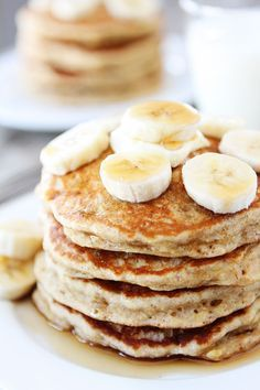 Banana Pancakes Recipe on twopeasandtheirpod.com Light, fluffy pancakes that will remind you of banana bread!