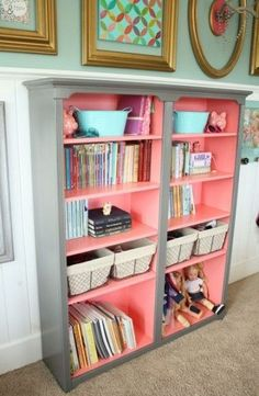 One color on the outside and another in the inside of a book case! Great for a grey nursery with a pop of color