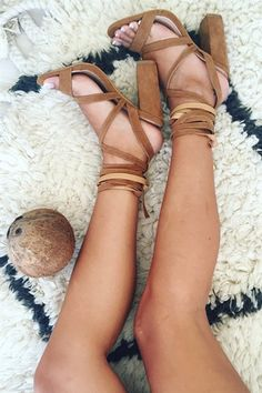 BACK IN STOCK DUE TO POPULAR DEMAND! <br/>We love strappy shoes, especially these tan suede tie-ups! Introducing Tan Suede Wrap Heels in a dark tan hue that features a thicker heel for extra comfort and a strap over the toe that crosses over the foot and around the ankle. These can be worn tied up the leg or stacked around the ankle. By Billini.