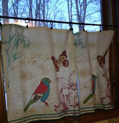 Dish towels from Cost Plus World Market (hemmed with iron on hem tape), spray painted tension rod and curtain clips. Cafe curtains for the kitchen window.