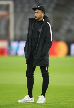 Kylian Mbappe Photos - Kylian Mbappe of PSG walks on the pitch on the eve of their UEFA Champions League match against Bayern Muenchen at Allianz Arena on December 4, 2017 in Munich, Germany. - Paris Saint-Germain Training And Press Conference