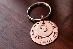 Hand stamped African Adoption Keychain - Copper, Brass or Silver Nickel - 1 inch and 1/2 inch disc (adoption fundraiser). $10.00, via Etsy.