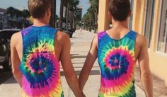 2015-08-10: Lovebirds Tom Daley and Dustin Lance Black wear their pride while on vacation in Orlando, Florida.