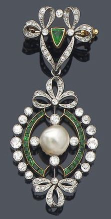An early 20th century diamond, emerald and pearl pendant/brooch, circa 1910 The brooch surmount composed of a diamond-set double ribbon-bow motif with central triangular-cut emerald accent, suspending an oval pendant centred by an 8.8mm. bouton-shaped pearl, within borders of calibré-cut emeralds and collet mounted old brilliant-cut diamonds principal diamonds approx. 0.60ct. total, length 6.0cm.
