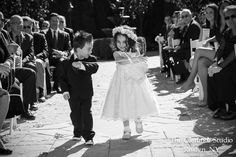 www.glenmarstudio.com Adorable shot of the #ringbearer and #flowergirl walking down the aisle. #wedding #aisle #weddingceremony #bridalparty #flowers #flowerbasket #minitux #flowergirldress #brideandgroom #bride #groom #couple #love #ido #vows #marriage #mrandmrs #weddingday #weddingphotoinspiration #aisleperfect #weddingwire #theknot #smpweddings #weddingphotography #photography #photographystudio #glenmarstudio #longislandwedding