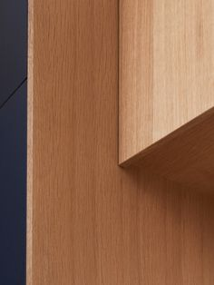 Basis Linoleum in the colour 'Smokey Blue' with handles and edges in oak.