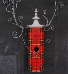 Plaid whimsicality: Tartan Plaid Thermos Birdhouse by thedustyraven.When the wind blows up the kilts and your wee chickadees are chilly, this unusual birdhouse will keep them snug.It was created using a vintage thermos, a couple yards of barbed wire and a fanciful metal lid for the roof.